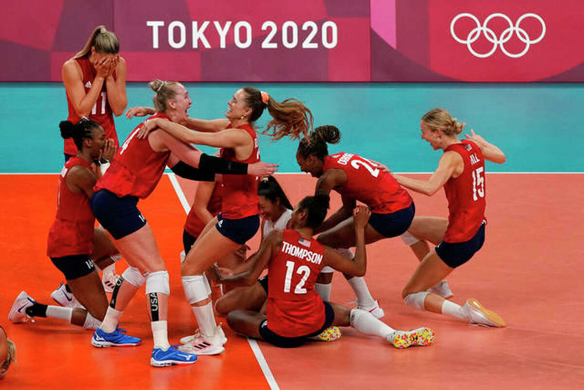 Players from the United States react after defeating Brazil to win the gold medal in women's volleyball at the 2020 Summer Olympics, Sunday, Aug. 8, 2021, in Tokyo, Japan.