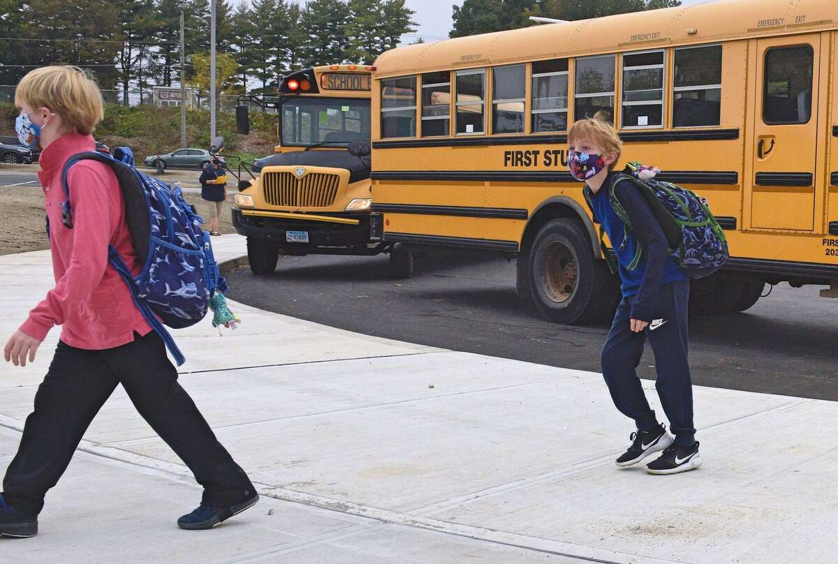 Students in the nearby town of Bethel head into school wearing masks in September 2020.
