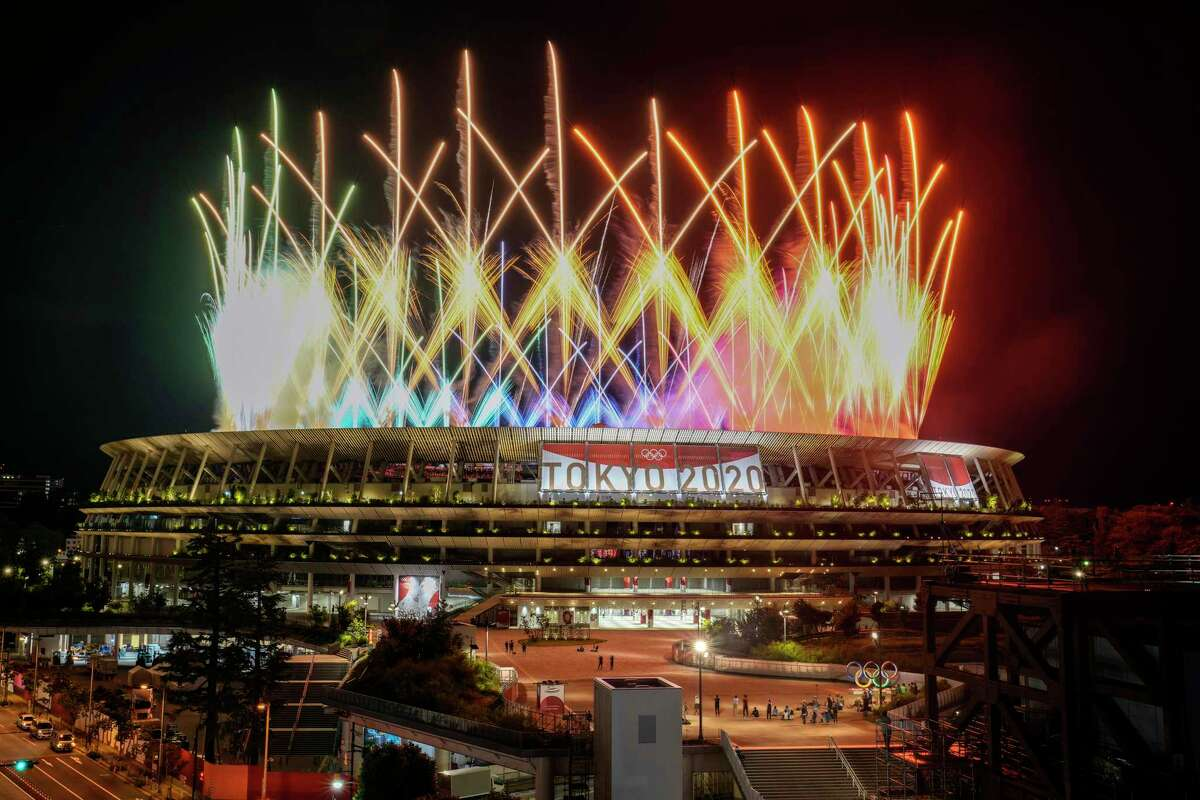 Fireworks illuminate over National Stadium during the closing ceremony of the 2020 Tokyo Olympics, Sunday, Aug. 8, 2021, in Tokyo.