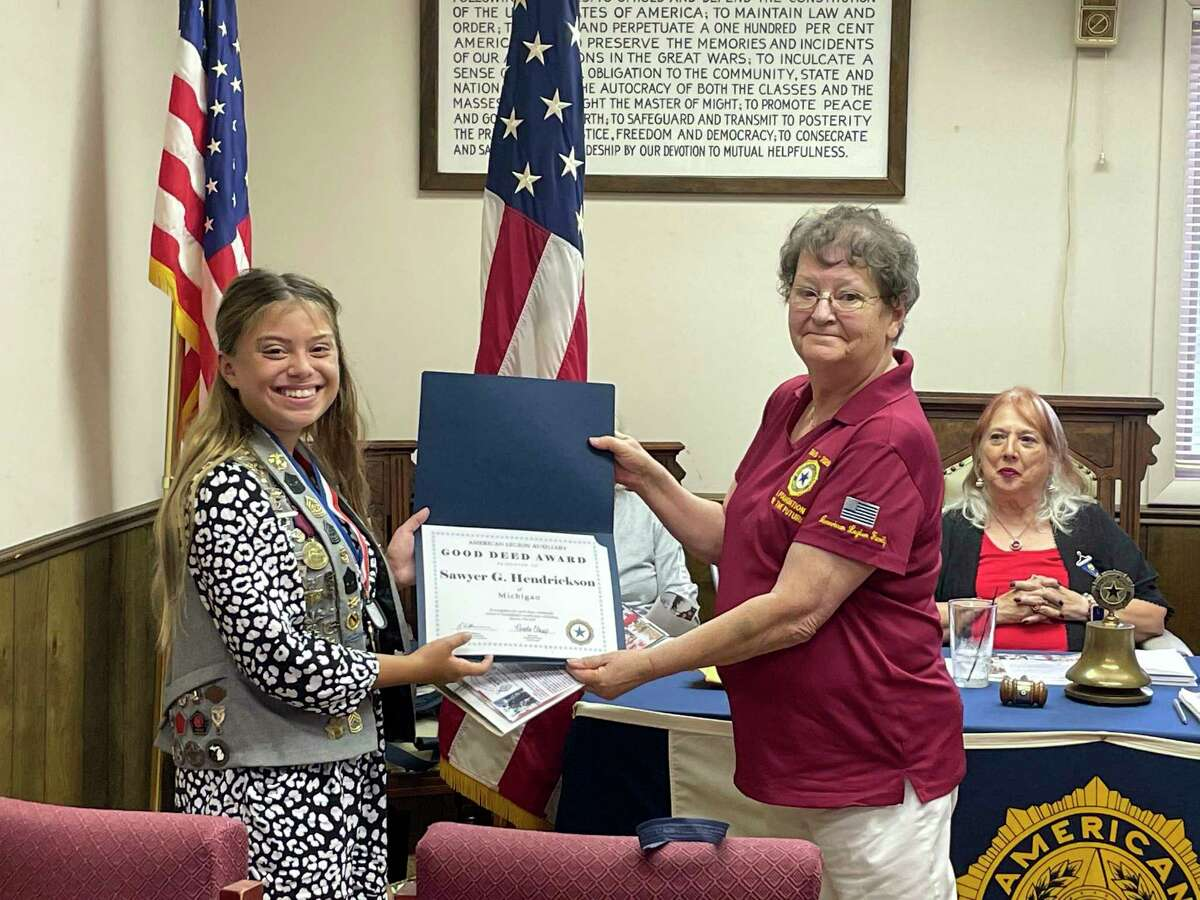Sawyer Hendrickson (left), of Ludington, receives the American Legion National Department'sGood Deed Award from District 9 president Sharon Reynolds for her work with her own nonprofit: Miss Sawyer's Kids with a Cause. (Courtesy photo)