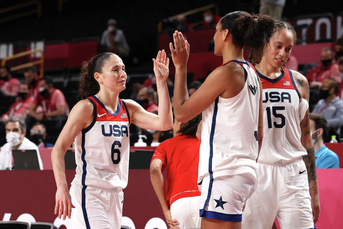 SAITAMA, JAPAN - AUGUST 08: Sue Bird #6 of Team United States high-fives teammate A'Ja Wilson #9 during the second half of the Women's Basketball final game on day sixteen of the 2020 Tokyo Olympic games at Saitama Super Arena on August 08, 2021 in Saitama, Japan. (Photo by Gregory Shamus/Getty Images)
