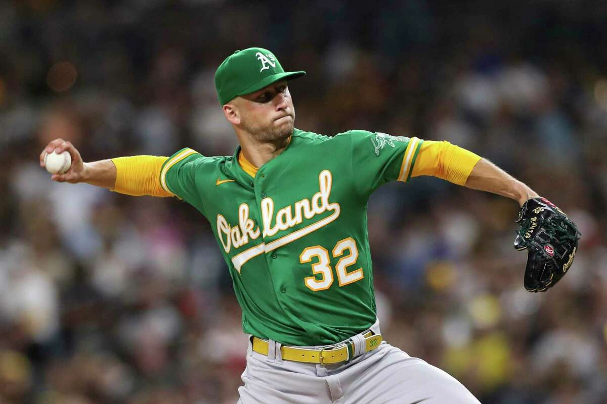 Oakland Athletics starting pitcher James Kaprielian winds up during the fifth inning of the team's baseball game against the San Diego Padres on Tuesday, July 27, 2021, in San Diego. (AP Photo/Derrick Tuskan)