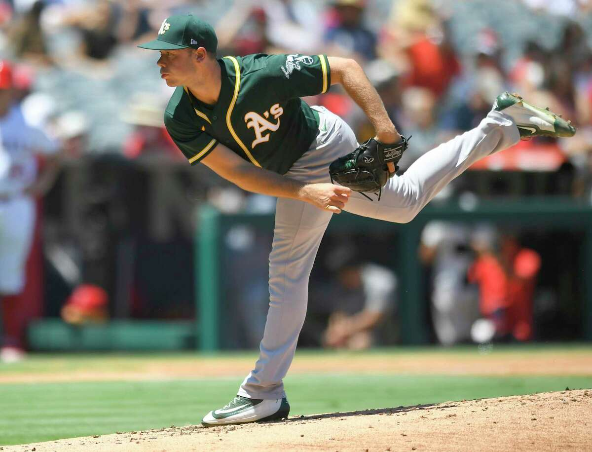 Oakland Athletics starting pitcher Daulton Jefferies throws in the first inning of a baseball game against the Los Angeles Angels, Sunday, Aug. 1, 2021, in Anaheim, Calif. (AP Photo/John McCoy)
