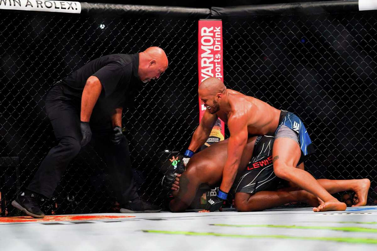 HOUSTON, TX - AUGUST 07: Ciryl Gane punches Derrick Lewis in the third round of their Heavyweight bout at Toyota Center on July 7, 2021 in Houston, Texas.
