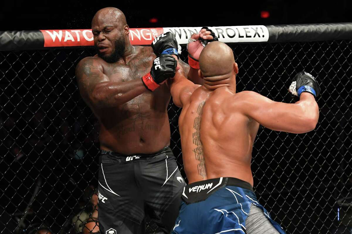 Ciryl Gane lands a big left hand that hurt Derrick Lewis late in the third round of theirinterim heavyweight title bout during the UFC 265 event at Toyota Center on August 07, 2021 in Houston, Texas.