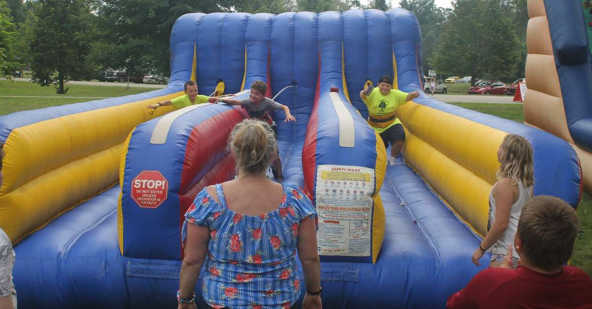 Three children compete in the bungee run at Copemish Days Heritage Festival on Saturday.