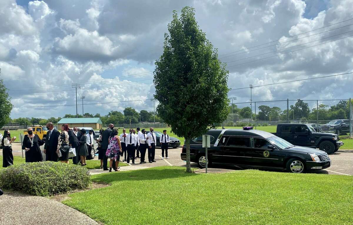 A hearse sits outside Our Mother of Mercy Church in Beaumont as family members gather outside of Anthony Guillory's memorial service on Saturday.