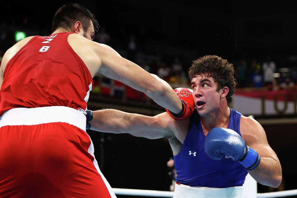 TOKYO, JAPAN - AUGUST 08: Bakhodir Jalolov of Team Uzbekistan (L) punches Richard Torrez Jr of Team United States during the Men's Super Heavy (+91kg) Final bout between Bakhodir Jalolov of Team Uzbekistan and Richard Torrez Jr of Team United States on day sixteen of the Tokyo 2020 Olympic games at Kokugikan Arena on August 08, 2021 in Tokyo, Japan. (Photo by Buda Mendes/Getty Images)