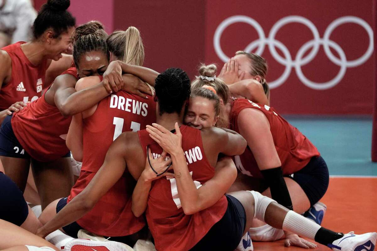 Players from the United States - including Stanford alum Foluke Akinradewo Gunderson (center, No. 16) - react after defeating Brazil to win the gold medal in women's volleyball at the Summer Olympics.