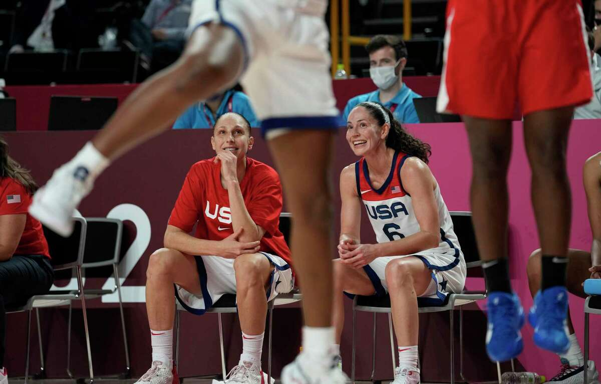 United States's Sue Bird (6), right, and teammate Diana Taurasi (12) watch from the bench during the women's basketball gold medal game against Japan at the 2020 Summer Olympics, Sunday, Aug. 8, 2021, in Saitama, Japan. (AP Photo/Eric Gay)