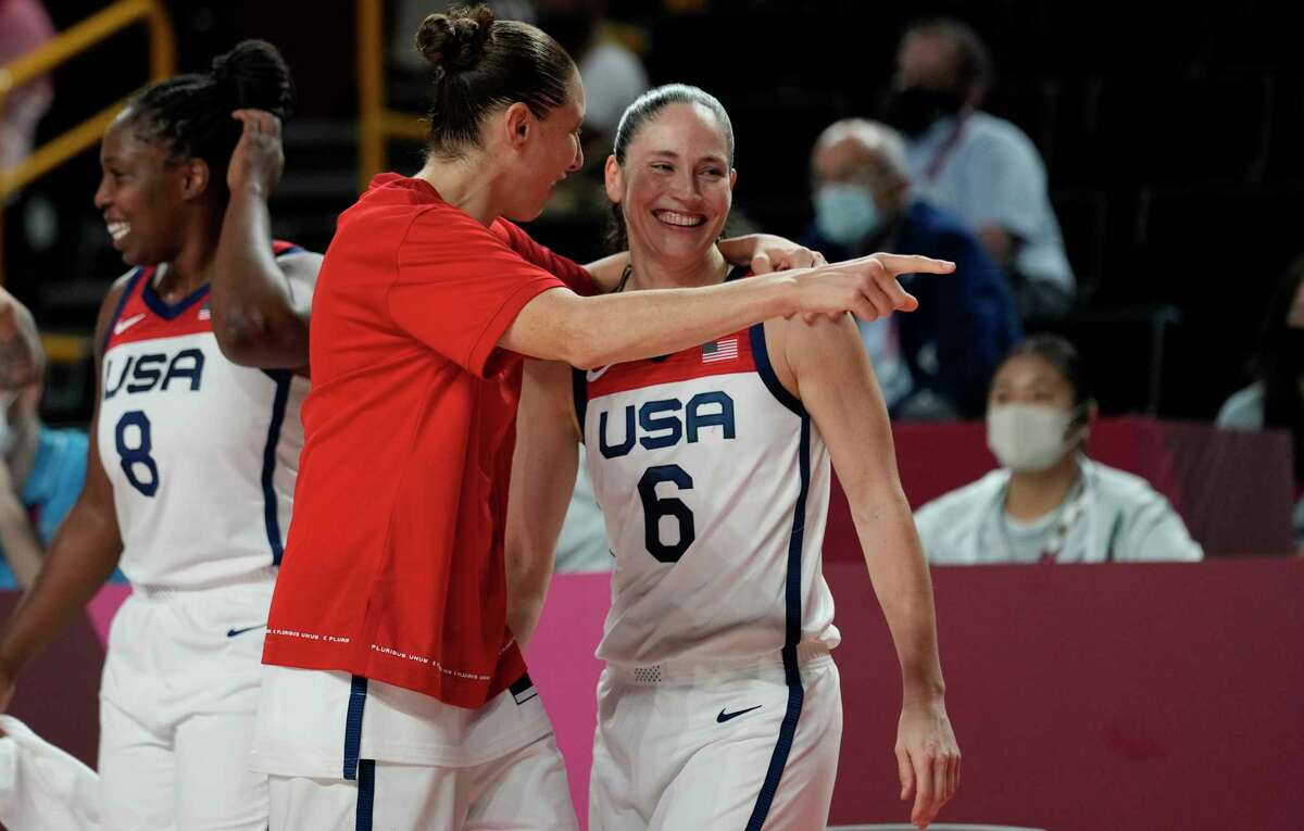 United States's Sue Bird (6), right, and teammate Diana Taurasi (12), center, celebrate after their win in the women's basketball gold medal game against Japan at the 2020 Summer Olympics, Sunday, Aug. 8, 2021, in Saitama, Japan. (AP Photo/Eric Gay)