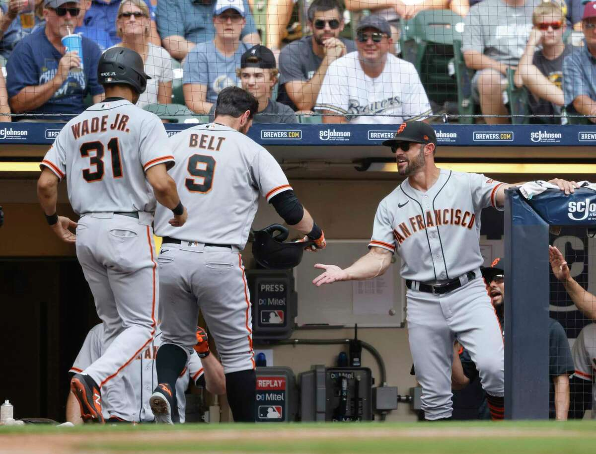 San Francisco Giants' Brandon Belt (9) receives congratulations after his two-run home run against the Milwaukee Brewers during the seventh inning of a baseball game Sunday, Aug. 8, 2021, in Milwaukee. (AP Photo/Jeffrey Phelps)