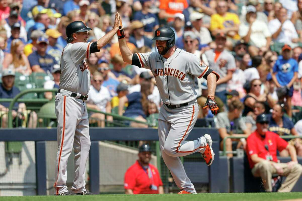 San Francisco Giants San Francisco Giants' Darin Ruf gets a high five from third base coach Ron Wotus after Ruf's home run during the first inning of a baseball game against the Milwaukee Brewers Sunday, Aug. 8, 2021, in Milwaukee. (AP Photo/Jeffrey Phelps)