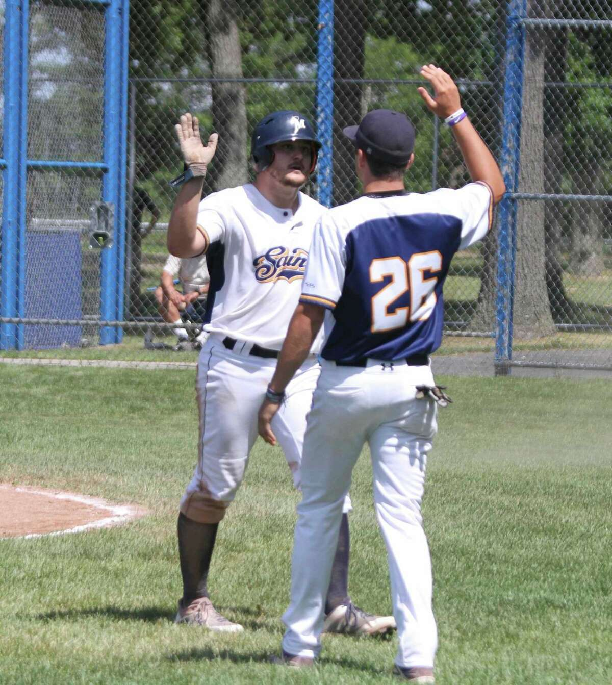 In this file photo, Manistee Saints outfielder Lucas Richardson celebrates a run scored during a game at Rietz Park in Manistee. (File photo)