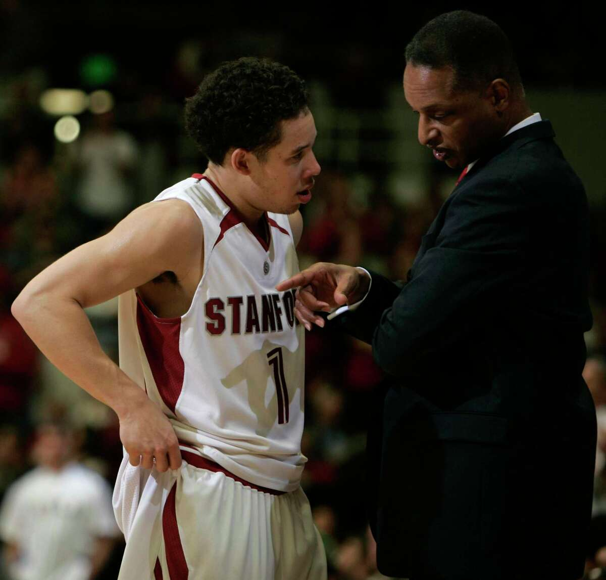 After four years at Stanford, Mitch Johnson, left, spent three years in the G League and overseas before turning to coaching. Now, he's been with the Spurs organization for six years.
