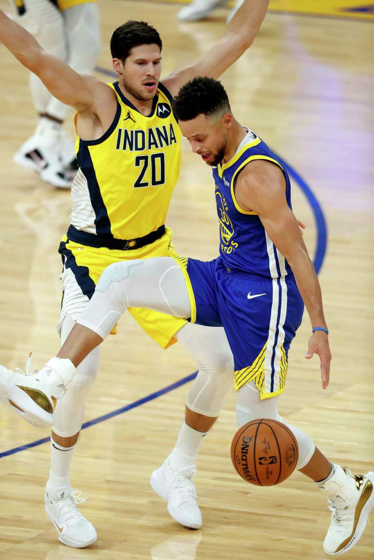 Golden State Warriors' Stephen Curry loses the ball after being fouled by the Indiana Pacers' Doug McDermott in the first quarter at Chase Center in San Francisco on Tuesday, Jan. 12, 2021.