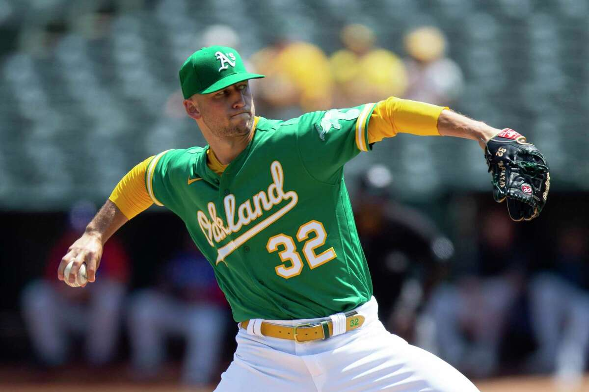 Oakland Athletics starting pitcher James Kaprielian (32) delivers against the Texas Rangers during the second inning of a baseball game, Sunday, Aug. 8, 2021, in Oakland, Calif. (AP Photo/D. Ross Cameron)