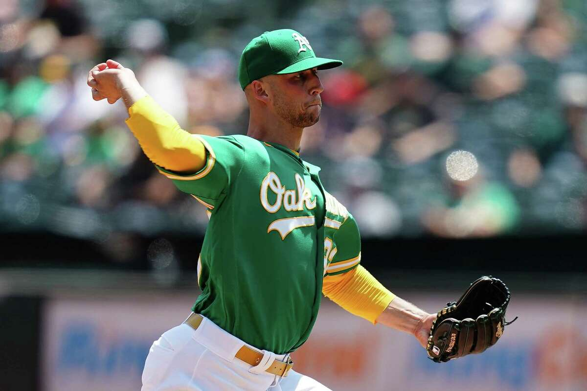 OAKLAND, CALIFORNIA - AUGUST 08: James Kaprielian #32 of the Oakland Athletics pitches against the Texas Rangers during the first inning at RingCentral Coliseum on August 08, 2021 in Oakland, California. (Photo by Ben Green/Getty Images)