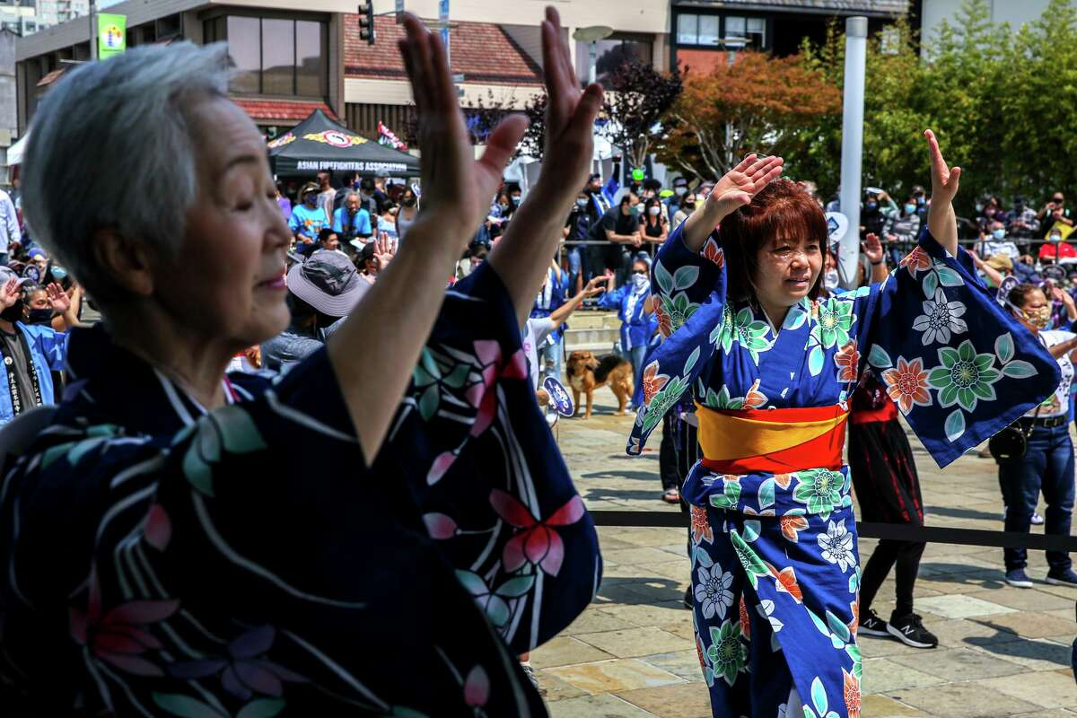 Shizuoka Ikeda (left) and Sumiyo Brennan lead people in a traditional Japanese dance during the annual Nihonmachi Street Fair in San Francisco, which this year hosted its own closing ceremony in celebration of the Olympics in Tokyo.