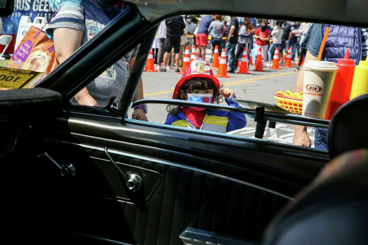 Akira Egushi, 3, looks insidea muscle car in the Sound of Thunder Car Show during the Nihonmachi Street Fair in San Francisco.