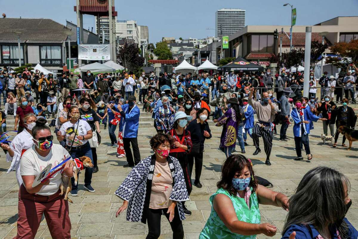 Dozens participate in a traditional Japanese dance during the annual Nihonmachi Street Fair in San Francisco.