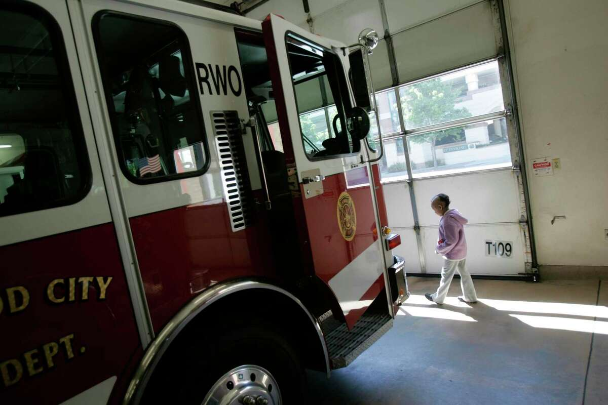 A fire truck sits in a Redwood City Fire Department station. Officials report that Whipple Avenue and Veterans Boulevard have been closed by a fire burining in the area.