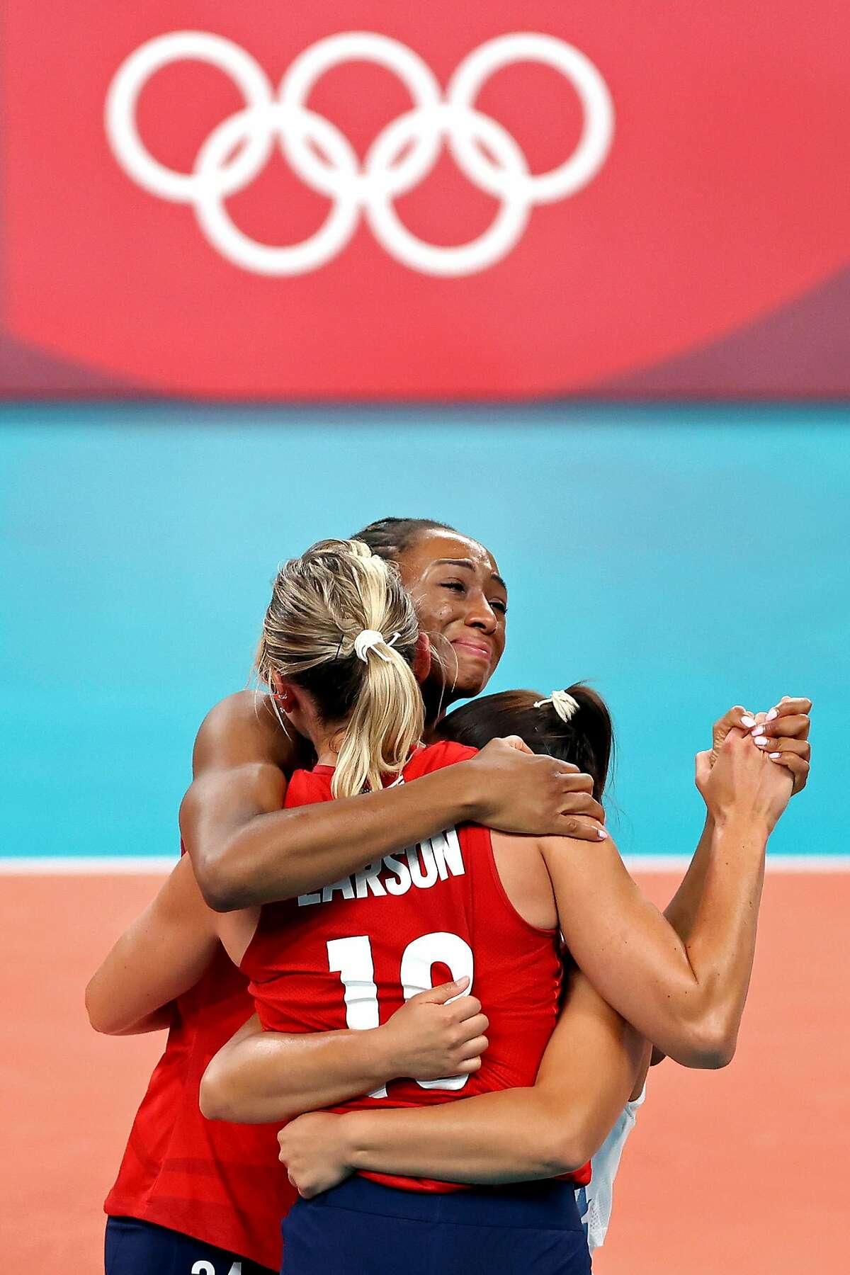 Foluke Akinradewo Gunderson (rear) celebrates with U.S. teammates after winning the elusive gold.