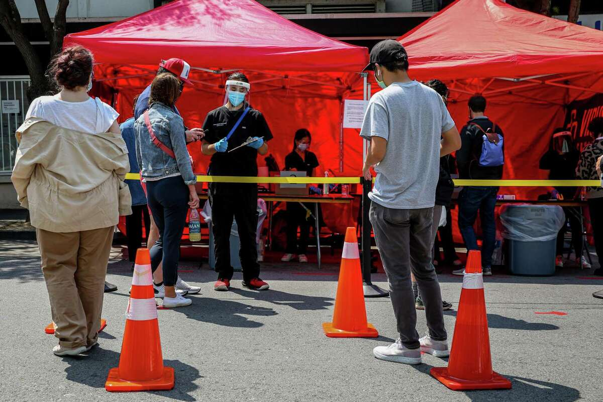 Visitors to the Nihonmachi Street Fair in Japantown are tested for the coronavirus this month. The delta surge has hit men in San Francisco particularly hard.