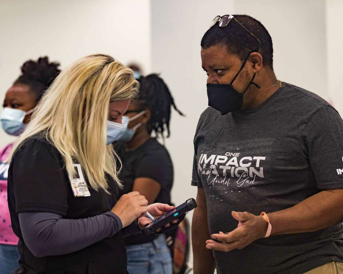 People get coronavirus vaccinations at an event sponsored by Impact Church in Jacksonville on Aug. 8.