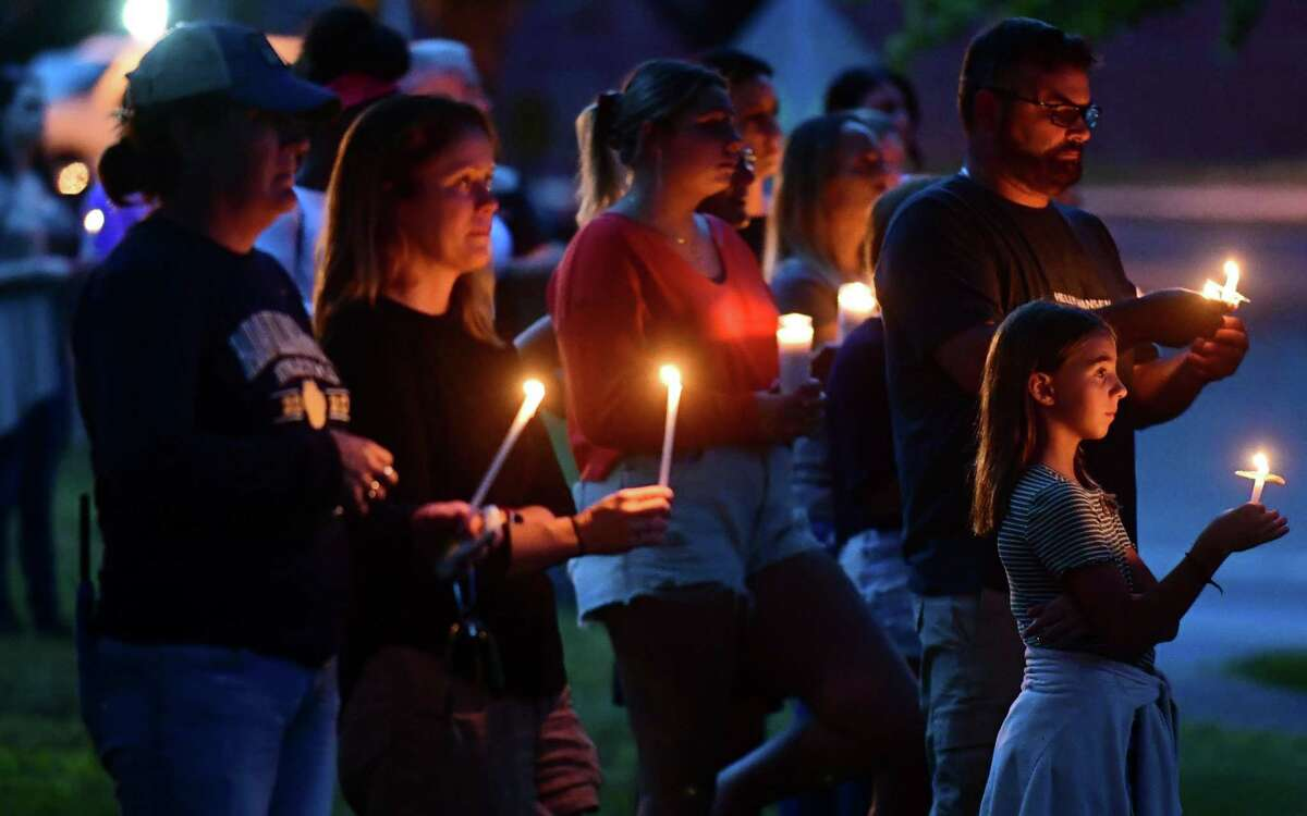 Supporters attend candlelight vigil for 14 year old Gianna Vincelett Saturday August 8, 2021, on the town green in Higganum, Conn. Vincelett was recently killed by a hit and run driver while riding her bicycle.