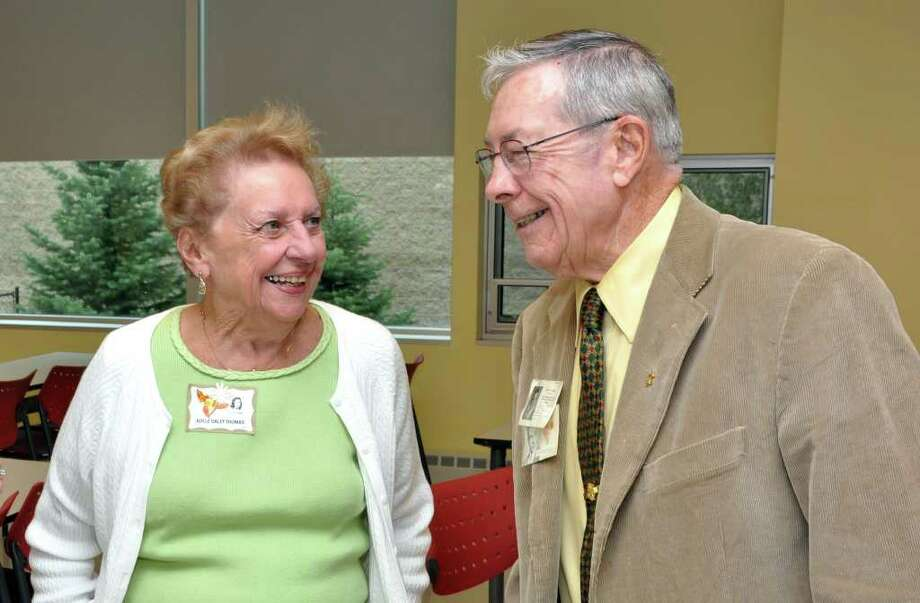 Adele Daley Thomas, of Fairfield, catches up with former classmate David Russell, of Fairfield, during Roger Ludlowe High School's class of 1945 reunion at Ludlowe Middle School on Sunday, Sept. 12, 2010. Photo: Amy Mortensen / Connecticut Post Freelance