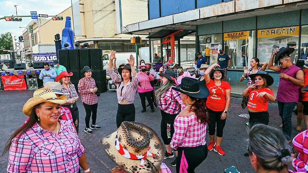 Zumba enthusiasts don cowboy hats as they dance Saturday, July 31, 2021 during Sombrero Fest in downtown Laredo.