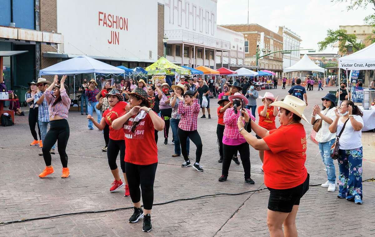Zumba enthusiasts wear cowboy hats as they dance during Sombrero Fest on Saturday, July 31, 2021.
