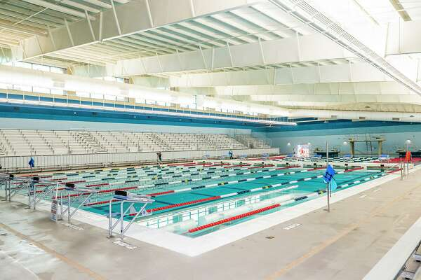 Aquatics Coordinator Louis Fruia gives a tour of the UISD Aquatic Center, Thursday, Aug. 5, 2021 during a preview of the new facility.