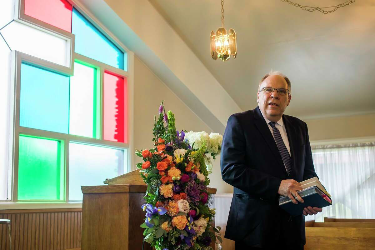 The Rev. Wally Mayton delivers a blessing during a ceremony honoring 15 individuals whose cremated remains had not been claimed, Friday, June 25, 2021 at Midland Memorial Gardens. The event was hosted by Ware-Smith-Woolever Funeral Directors.