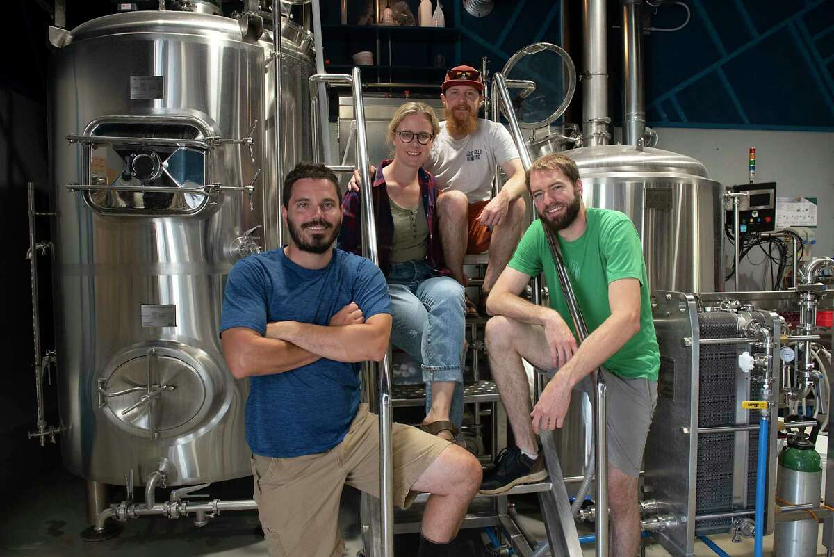 Co-owners, from left, Andrew Rowles, farm manager, Abbie Hansen, taproom manager/events manager, Adam Rosenthal, head brewer, and Kyle Bergen in the brewing area of Wayward Lane Brewing in Schoharie.