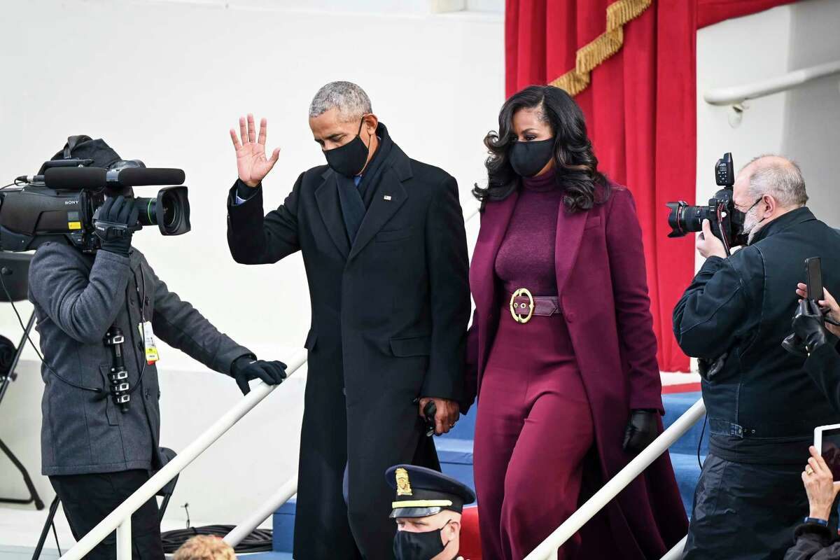 Barack and Michelle Obama arrive before Joe Biden is sworn in as 46th President of the United States on January 20, 2021 in Washington.
