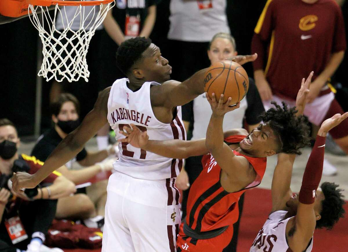 The Rockets' Jalen Green tries to get a shot past Cleveland's Mfiondu Kabengele during the 2021 NBA Summer League at the Thomas & Mack Center on August 8, 2021 in Las Vegas, Nevada.