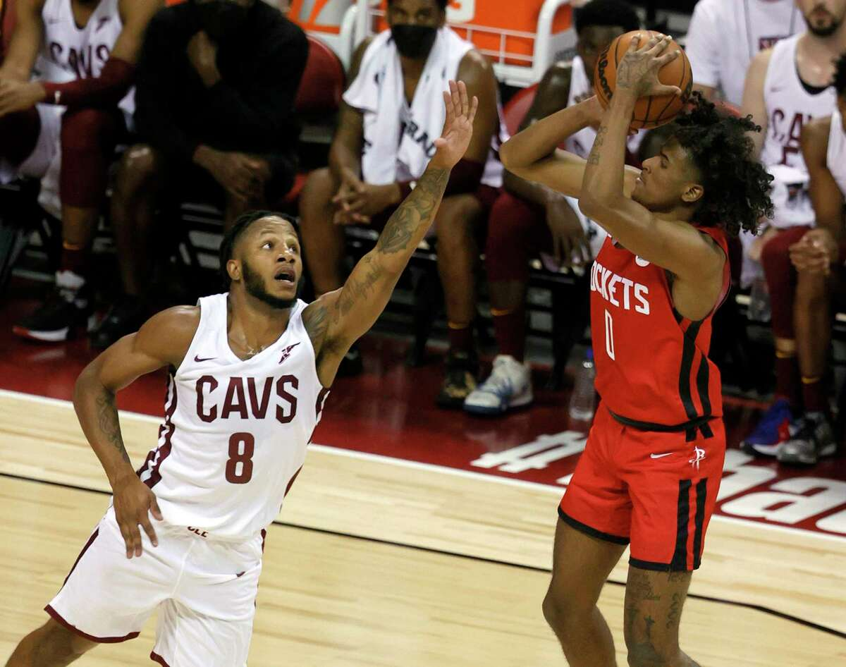 The Rockets' Jalen Green shoots over Cleveland's Lamar Stevens during the 2021 NBA Summer League at the Thomas & Mack Center on August 8, 2021 in Las Vegas, Nevada. The Rockets defeated the Cavaliers 84-76.
