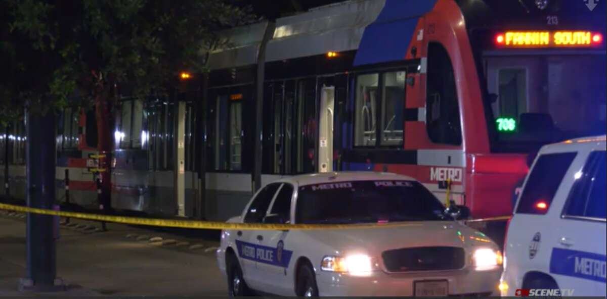Metro police at the scene where a light rail train hit a pedestrian Aug. 8, 2021, near the McGowen station in Midtown.