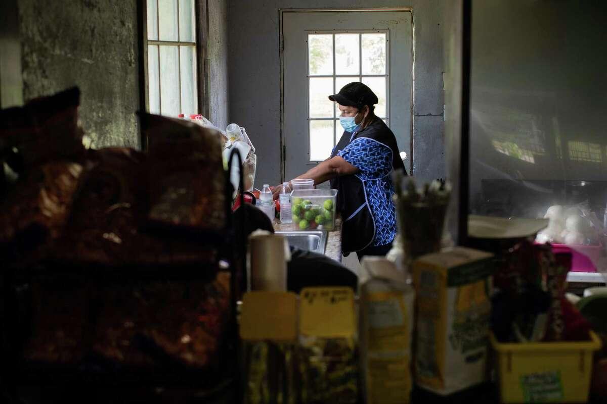 Neri Aguilar prepares food in her restaurant Pollos Asados Y Antojitos El JJ, Friday, July 30, 2021, in Cleveland.