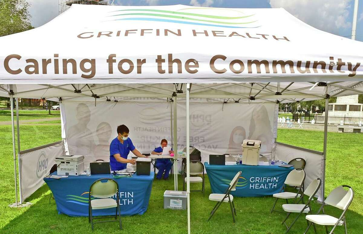 New Haven, Connecticut - Thursday, August 6, 2021: Griffin Health employees at a vaccination center Thursday on the New Haven Green.
