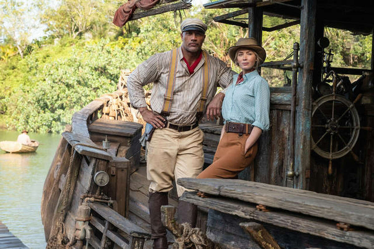 """Dwayne Johnson and Emily Blunt star in """"Jungle Cruise."""" Although based on Disneyland's theme park ride, the film is more like """"African Queen"""" meets """"Pirates of the Caribbean"""" meets """"Medicine Man."""""""