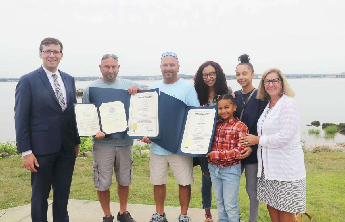 The U.S. Coast Guard in New London honored five Connecticut men who helped rescue five elderly individuals at sea in late June on Long Island Sound.