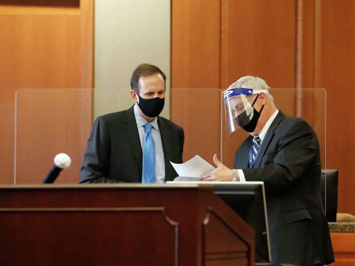 Attorney Randy Sorrels (left) wears a mask and Attorney Kent Adams wears a face shield in Harris County Judge Rabeea Sultan Collier's courtroom Wednesday, Feb. 3, 2021, in Houston.