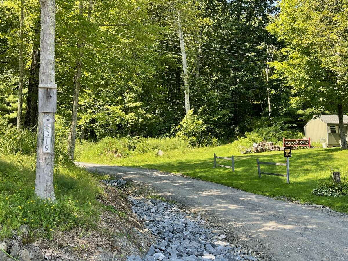This photograph shows the end of the driveway to the home where Craig E. Seeley lived with his family on Miller Road in Argyle. Seeley and his daughter, 34-year-old Katie MSeeley, died Saturday when his experimental helicopter crashed nearby.