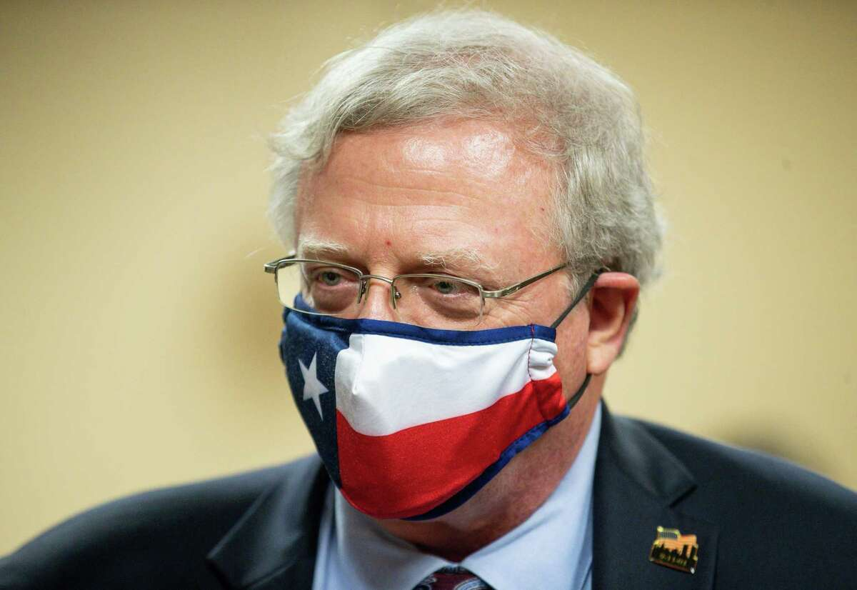 Senator Paul Bettencourt wears a Texas face mask while talking to reporters following the conclusion of a press conference Monday, March 15, 2021, in Houston.