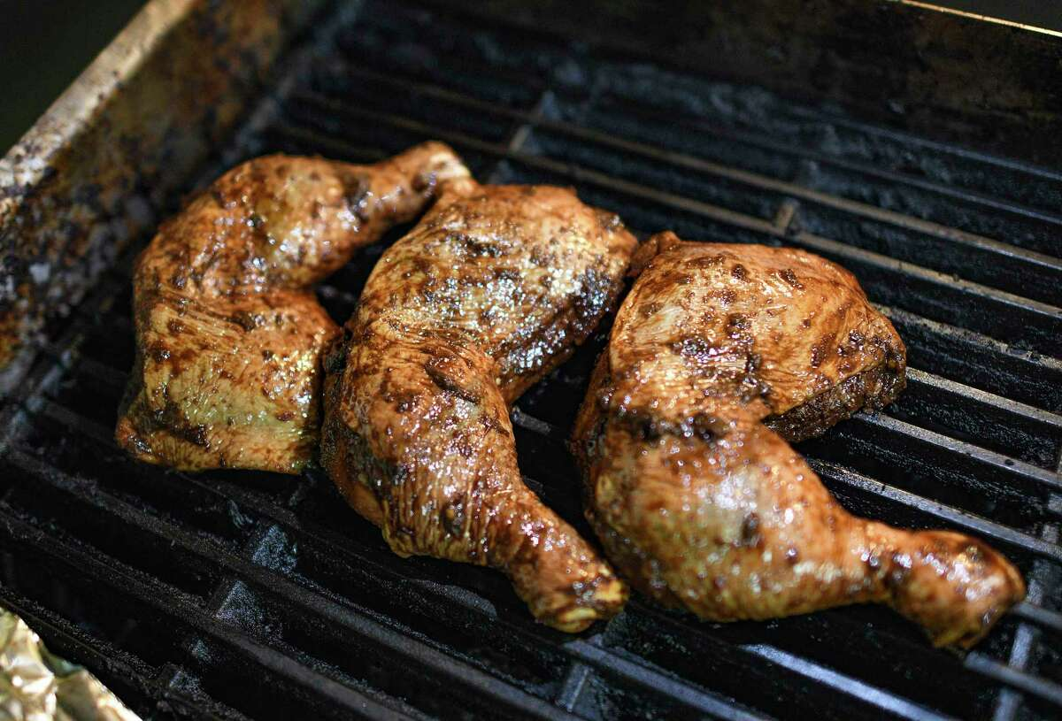 Jerk chicken is grilled at Jamaica Jamaica Cuisine at a low heat for approximately 90 minutes.