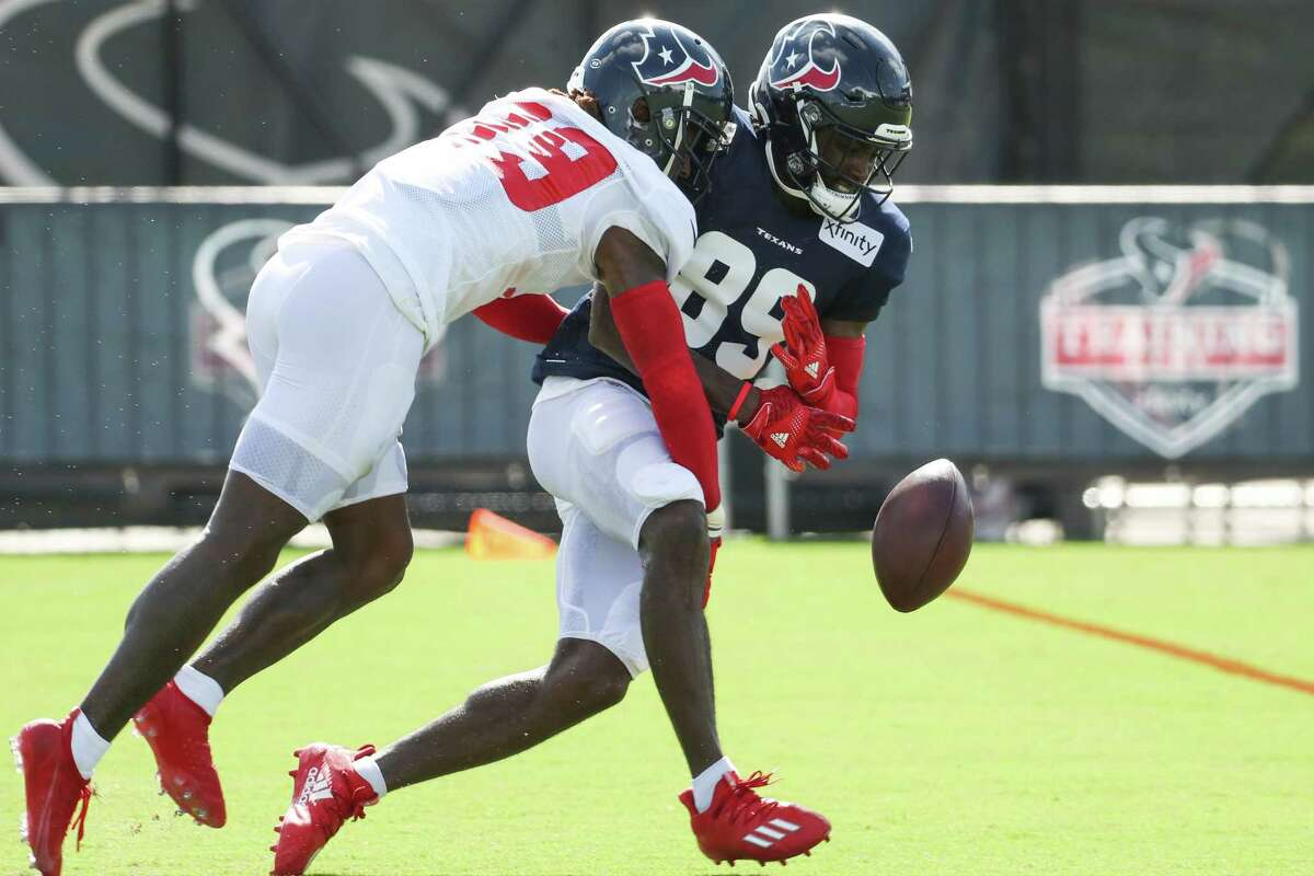 Houston Texans cornerback Terrance Mitchell (39) defends a pass to wide receiver Taywan Taylor (89) during an NFL training camp football practice Monday, Aug. 9, 2021, in Houston.