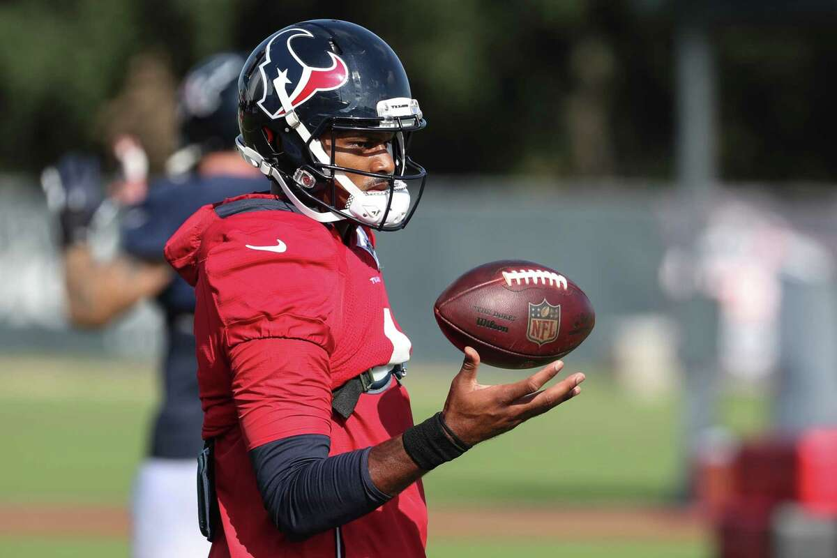 Houston Texans quarterback Deshaun Watson flips a ball in the air while warming up during an NFL training camp football practice Monday, Aug. 9, 2021, in Houston.